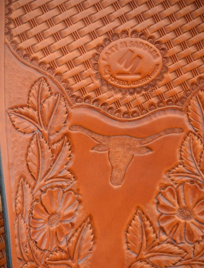 Lazy M saddle longhorn and roses